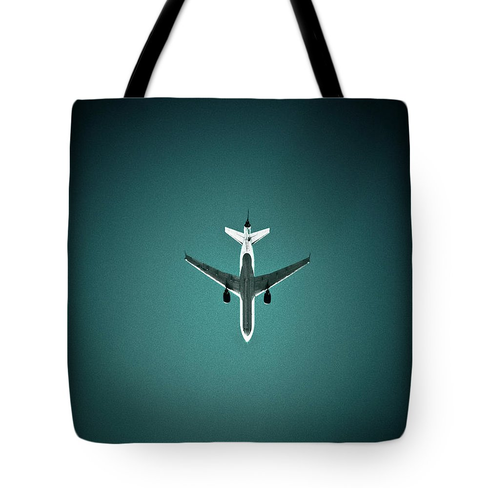 Outdoors Tote Bag featuring the photograph Airplane Silhouette by Miikka S Luotio