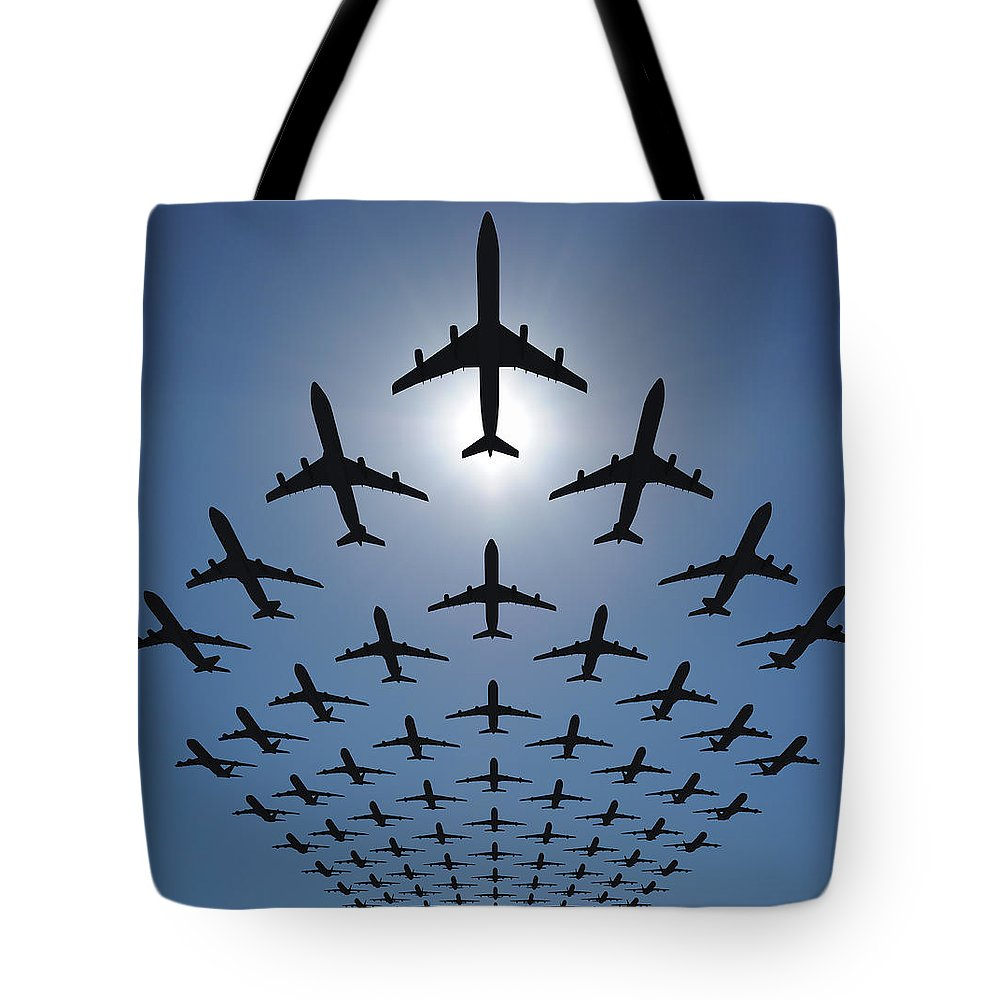 Expertise Tote Bag featuring the photograph Airplane Silhouettes Fly In V Formation by Georgo