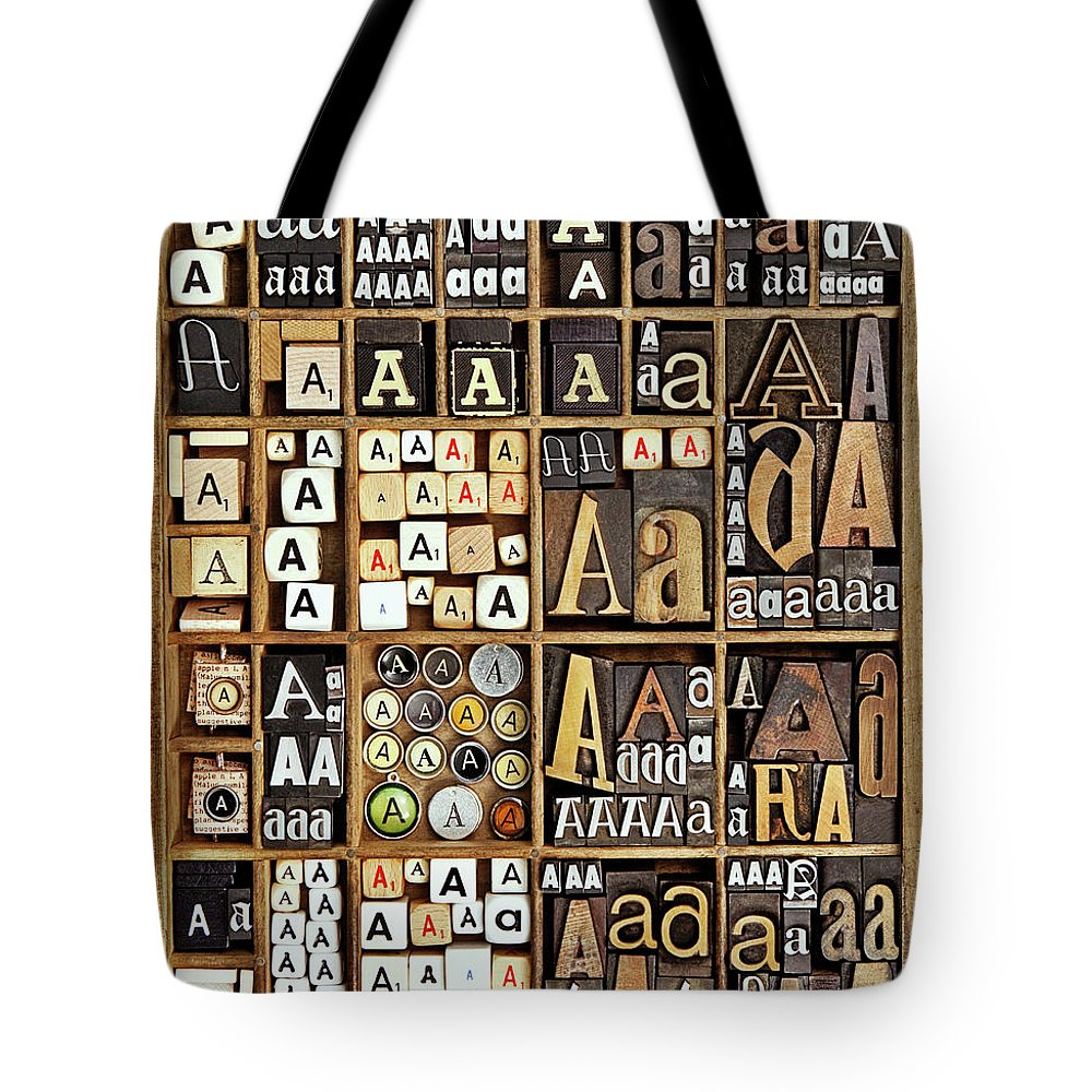 In A Row Tote Bag featuring the photograph Alphabet by Daryl Benson