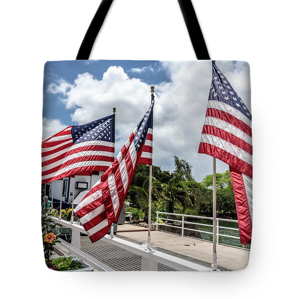 American Flags Tote Bag featuring the photograph American Flags Flying In The Wind by Brian Johnson