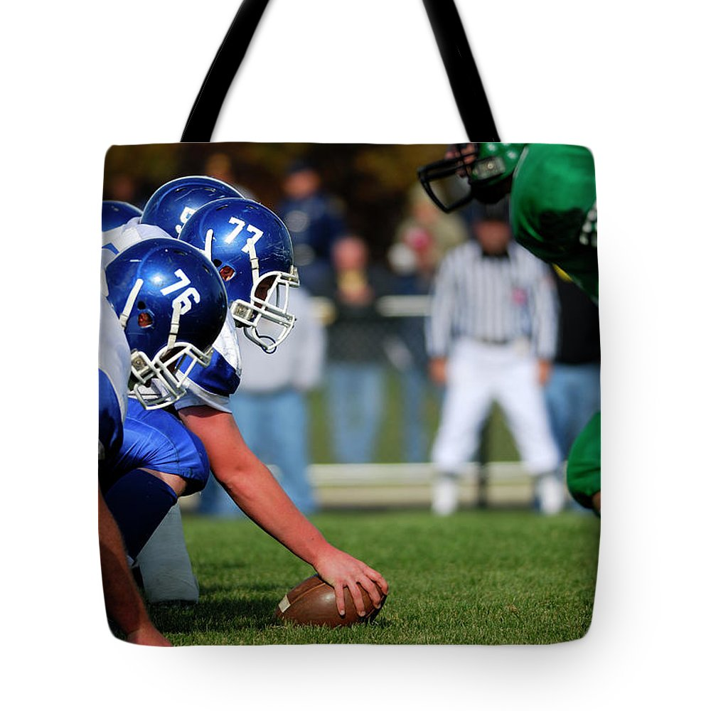 Sports Helmet Tote Bag featuring the photograph American Football Line Of Scrimmage by Groveb