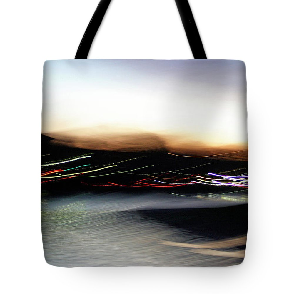 Blur Tote Bag featuring the photograph An Early Morning Blur by Cora Wandel
