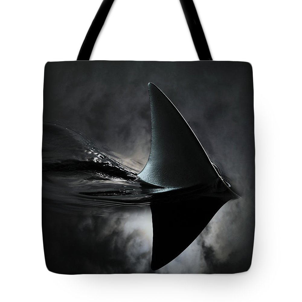 Risk Tote Bag featuring the photograph An Image Of A Shark Fin Against Moon by Jonathan Knowles