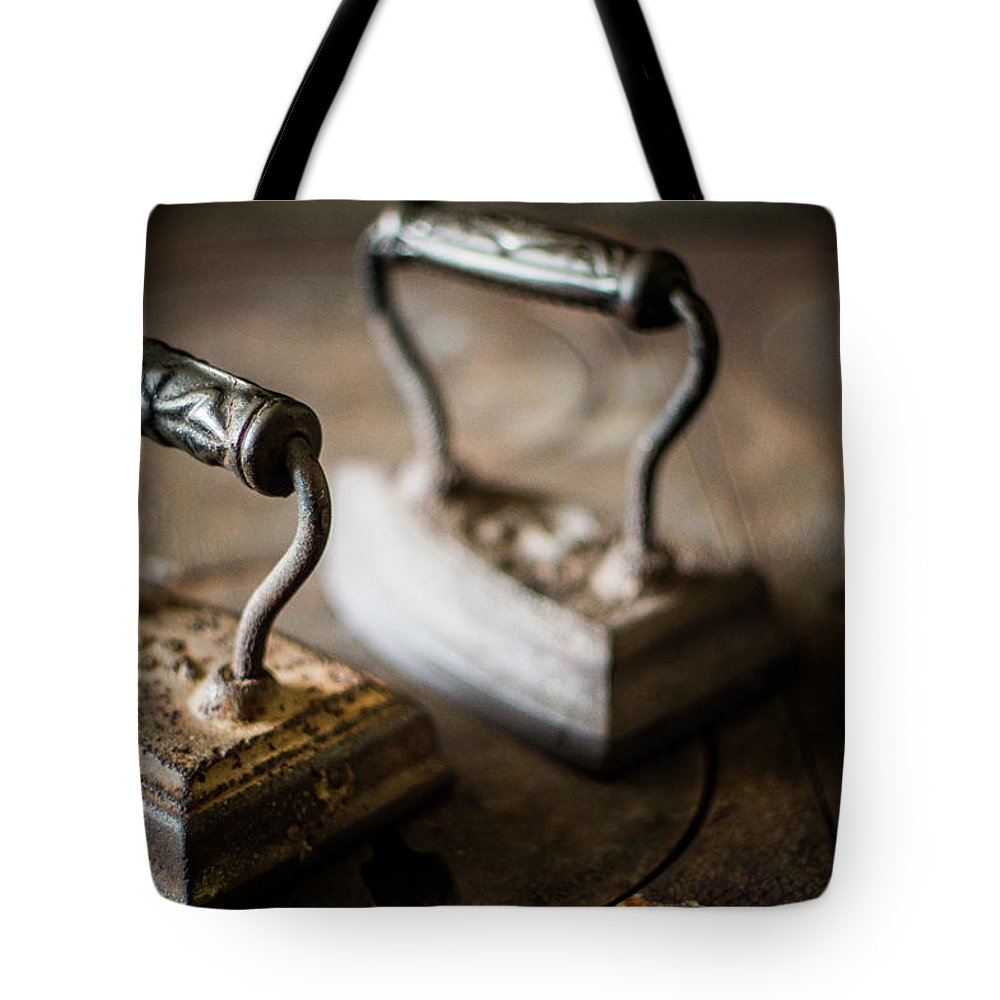 Two Objects Tote Bag featuring the photograph Antique Irons by Jimss