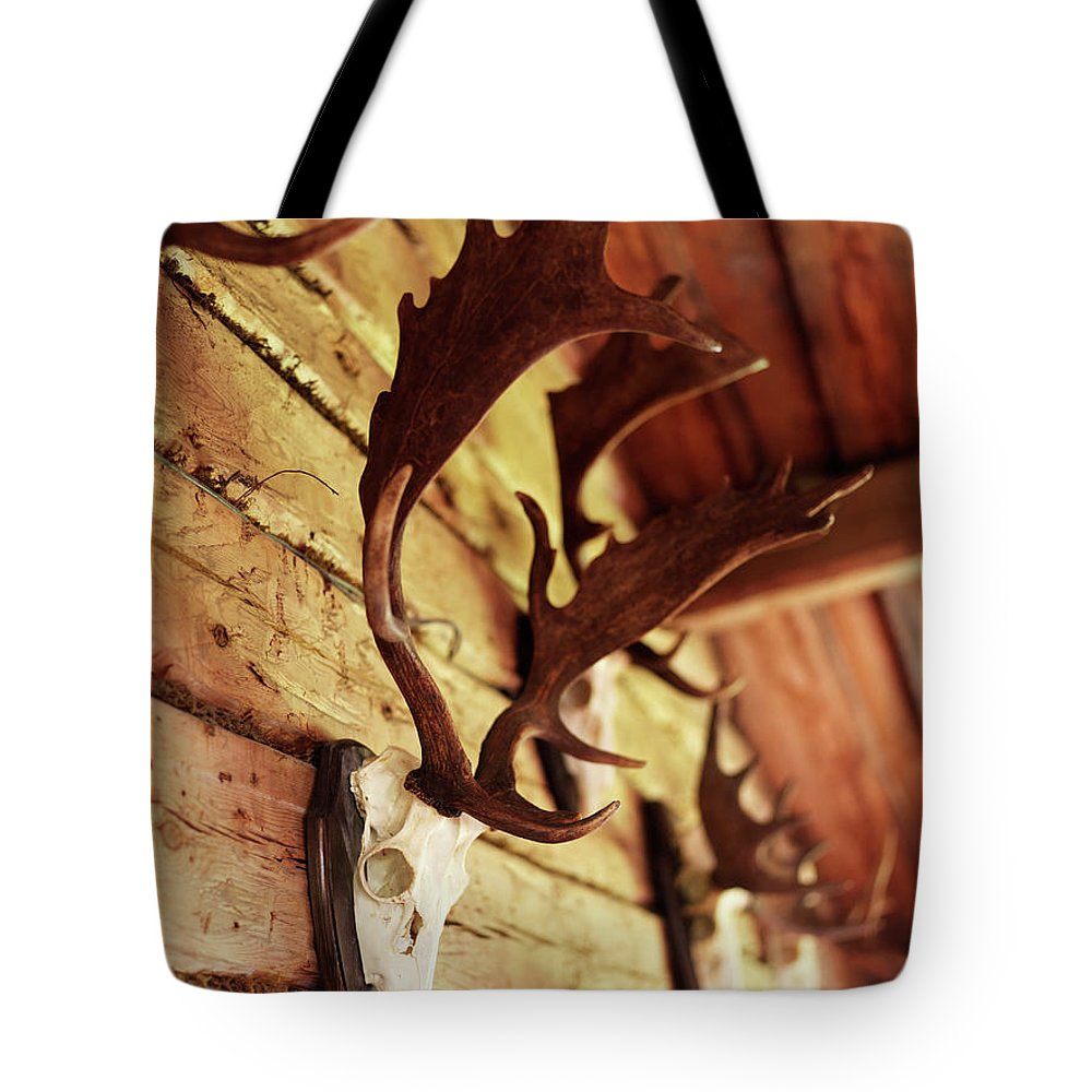 Horned Tote Bag featuring the photograph Antler Collection On Wall by Granefelt, Lena