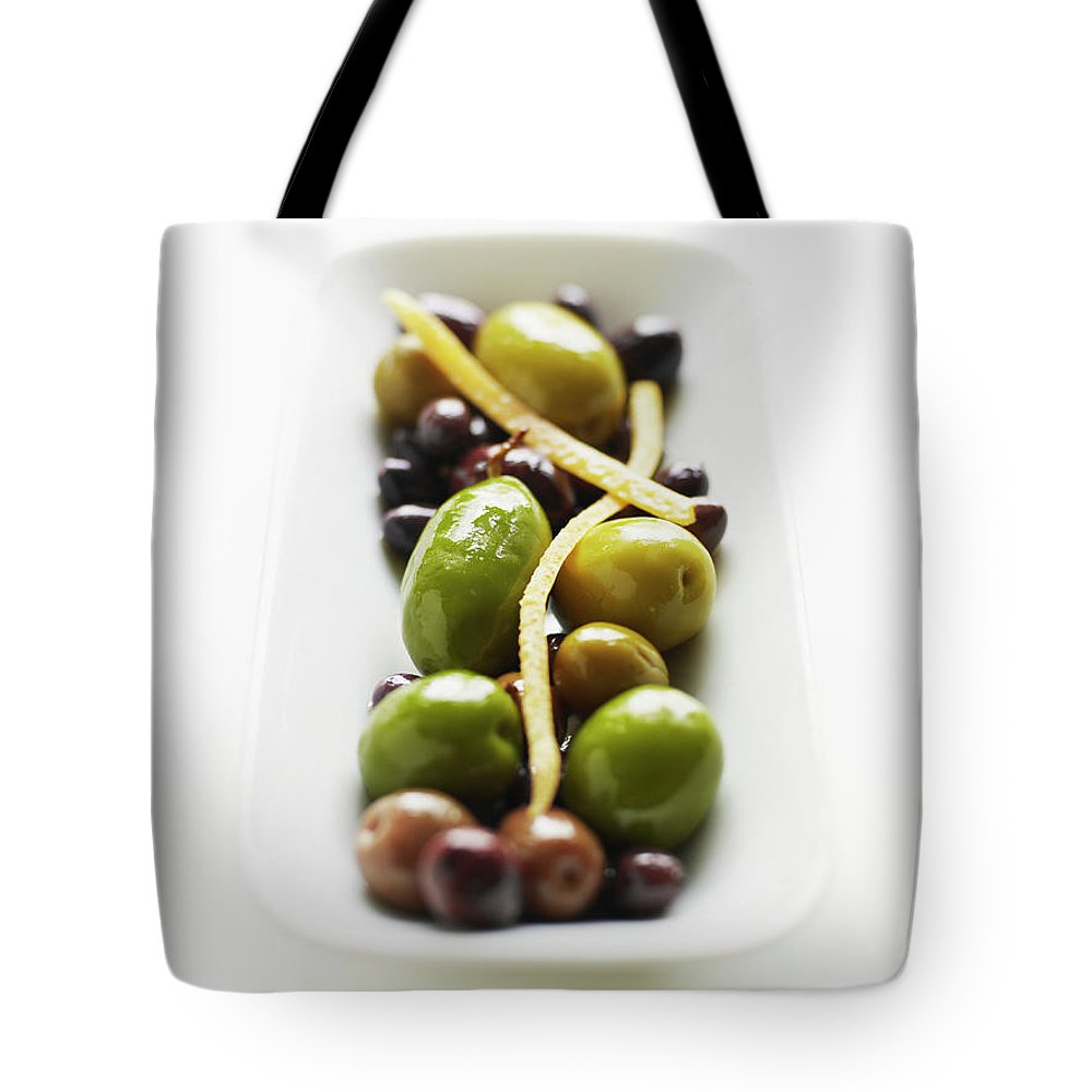 White Background Tote Bag featuring the photograph Appetizer Of Warm Marinated Olives by Thomas Barwick