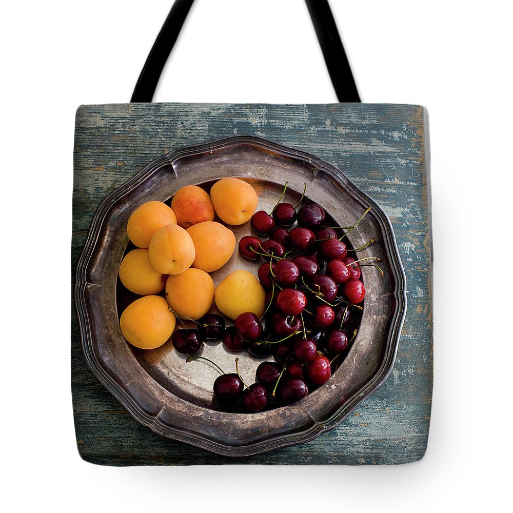 Tranquility Tote Bag featuring the photograph Apricots And Cherries On Silver Tray by Bjurling, Hans