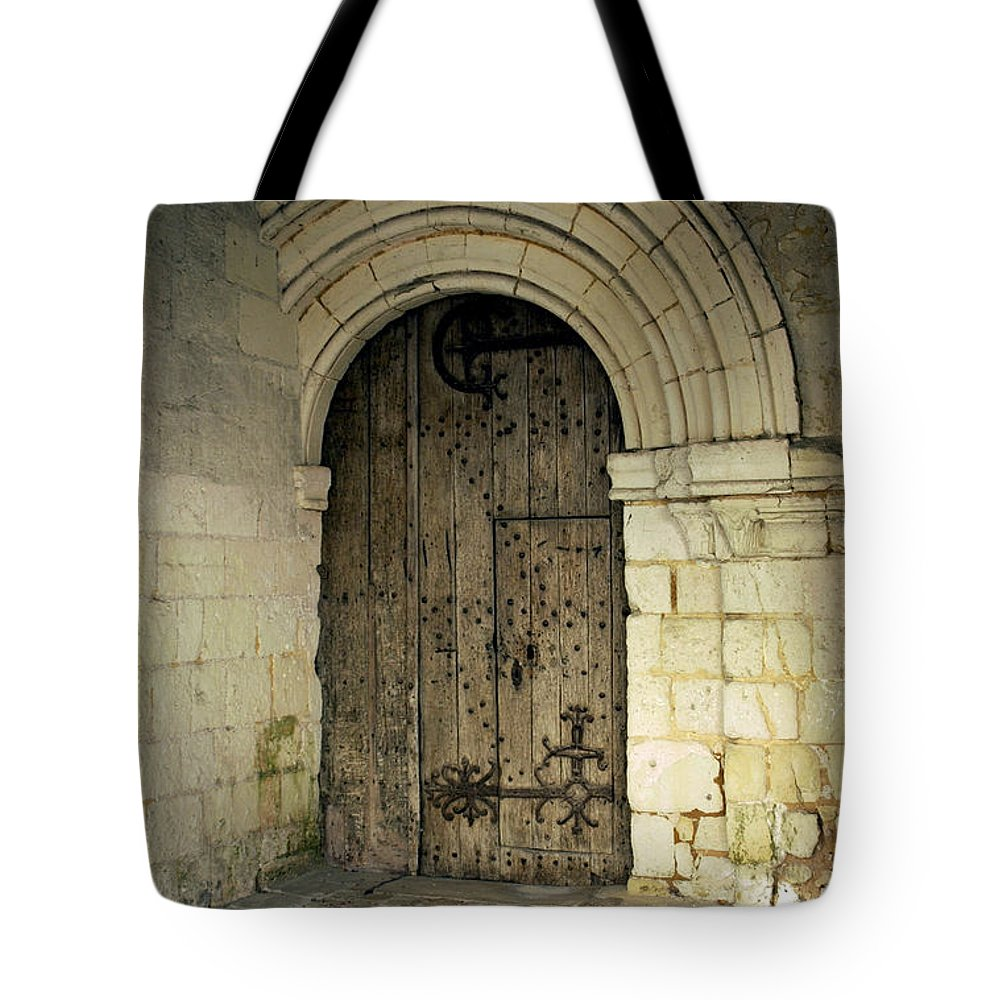 Door Tote Bag featuring the photograph arched door at Fontevraud church by Victor Lord Denovan