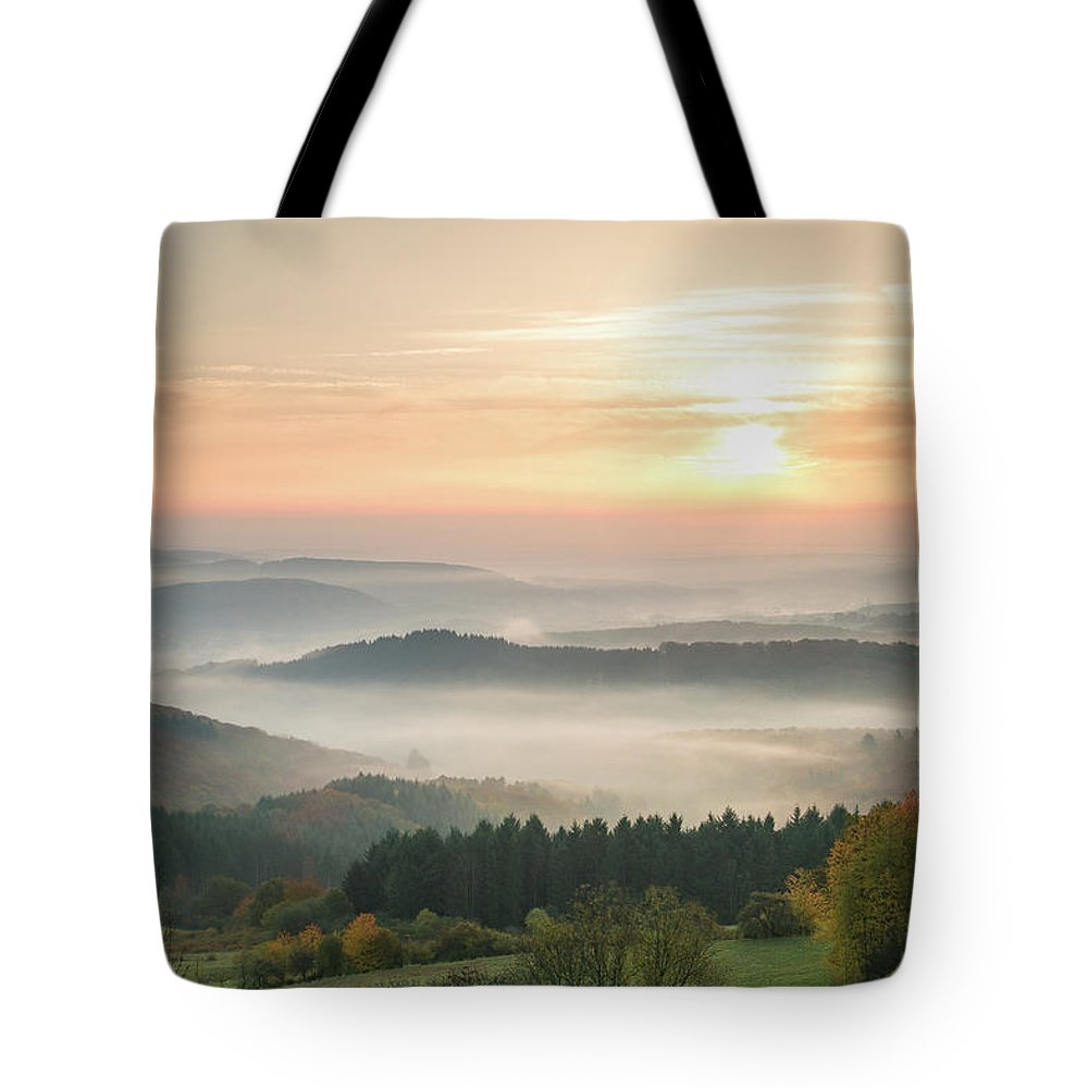 Scenics Tote Bag featuring the photograph Autumn Foggy Sunrise by Marcoschmidt.net