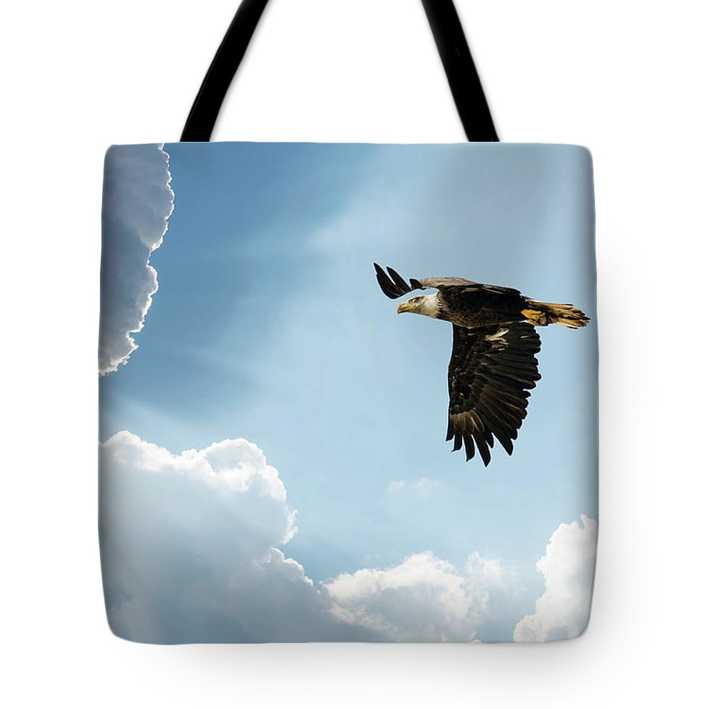 Bald Eagle Flying In Clouds Towards The Sun Tote Bag