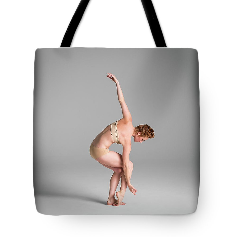Ballet Dancer Tote Bag featuring the photograph Ballerina In Studio Dancing by Nisian Hughes