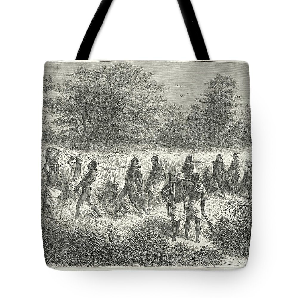19th Century Tote Bag featuring the mixed media Band Of Captives In The Village Of Mbame by After Emile Bayard