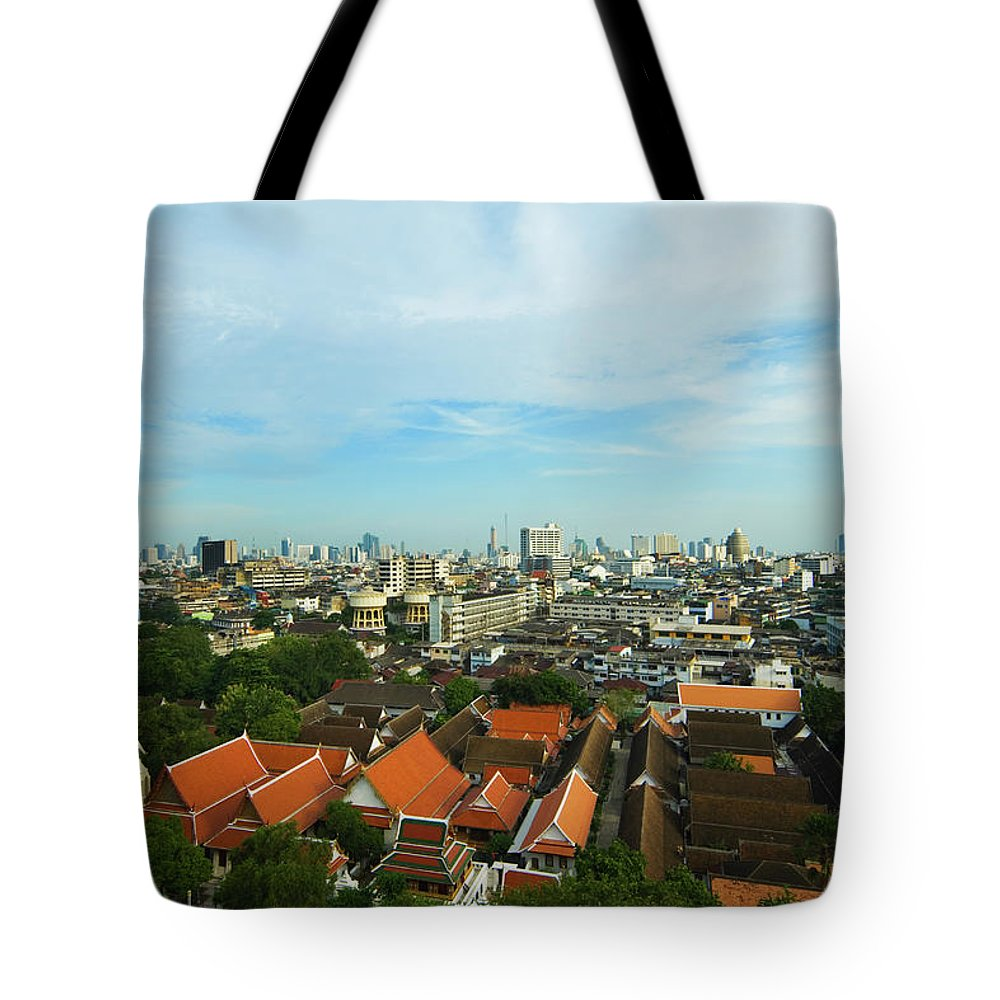 Tropical Tree Tote Bag featuring the photograph Bangkok View With Temple Roofs 2 by Sndrk