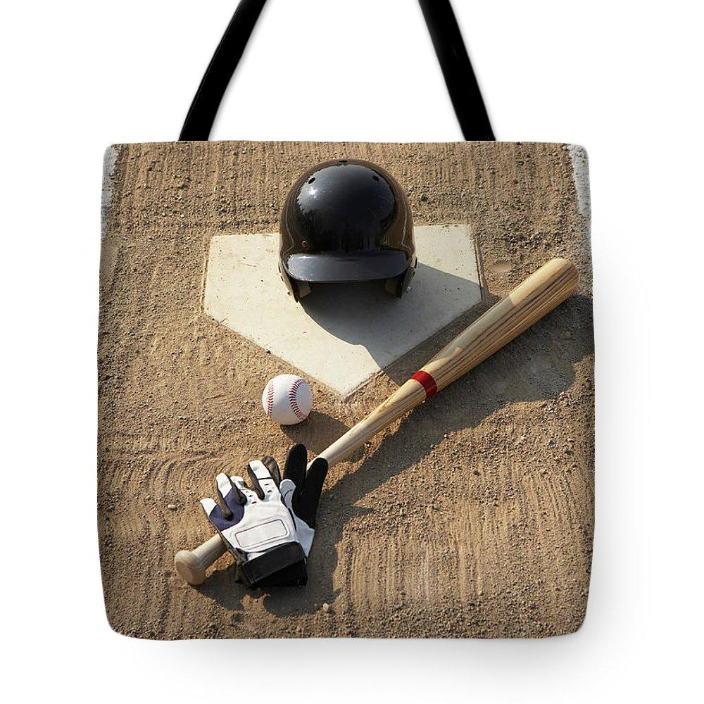 Shadow Tote Bag featuring the photograph Baseball, Bat, Batting Gloves And by Thomas Northcut