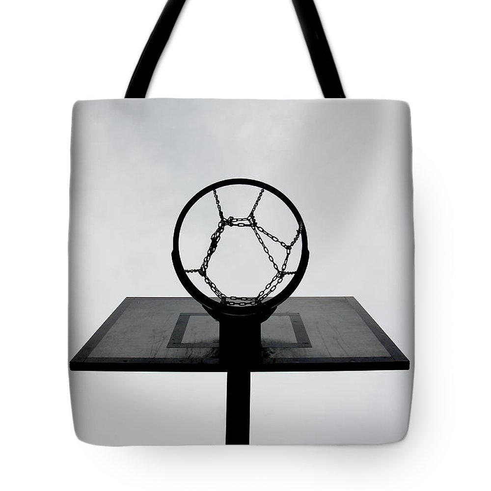 Outdoors Tote Bag featuring the photograph Basketball Hoop by Christoph Hetzmannseder