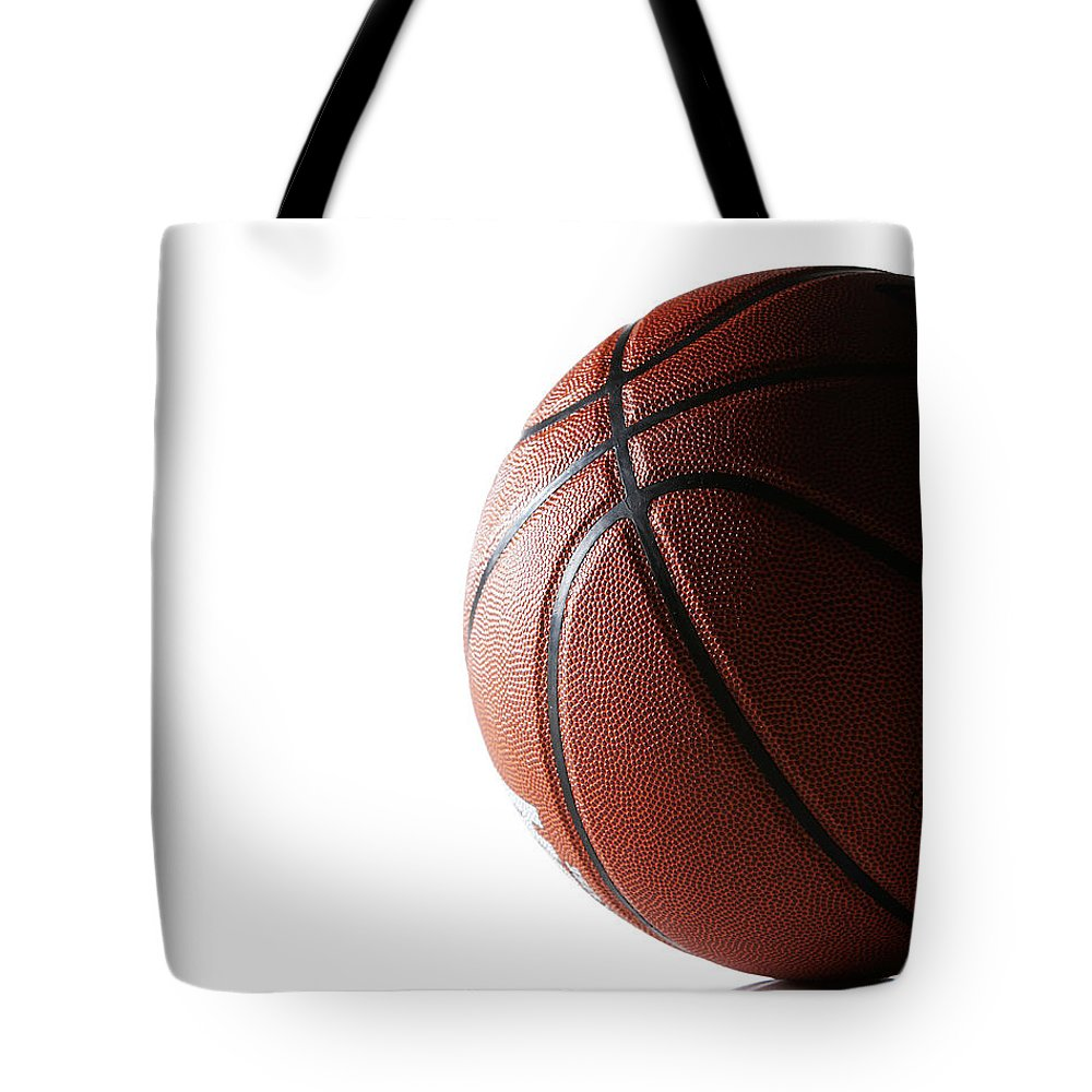 Recreational Pursuit Tote Bag featuring the photograph Basketball On White Background by Thomas Northcut