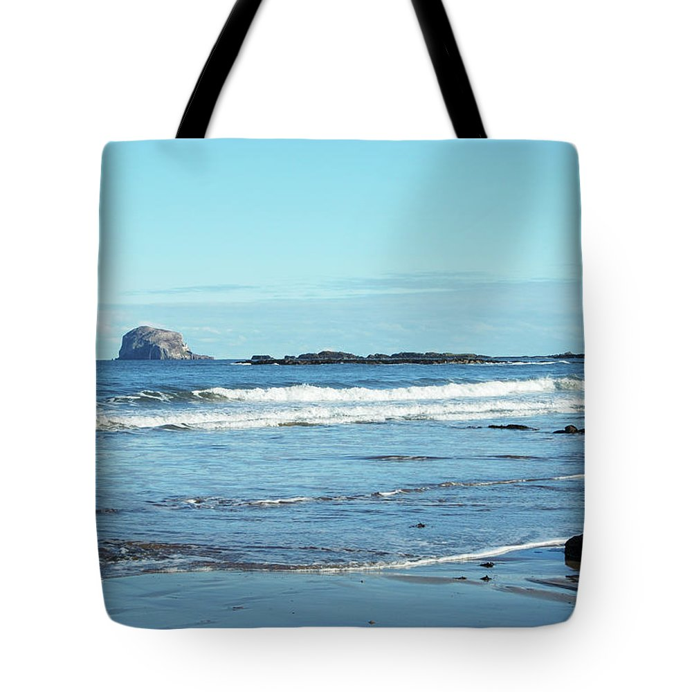 Bass Rock Tote Bag featuring the photograph Bass Rock And Beach At North Berwick by Victor Lord Denovan