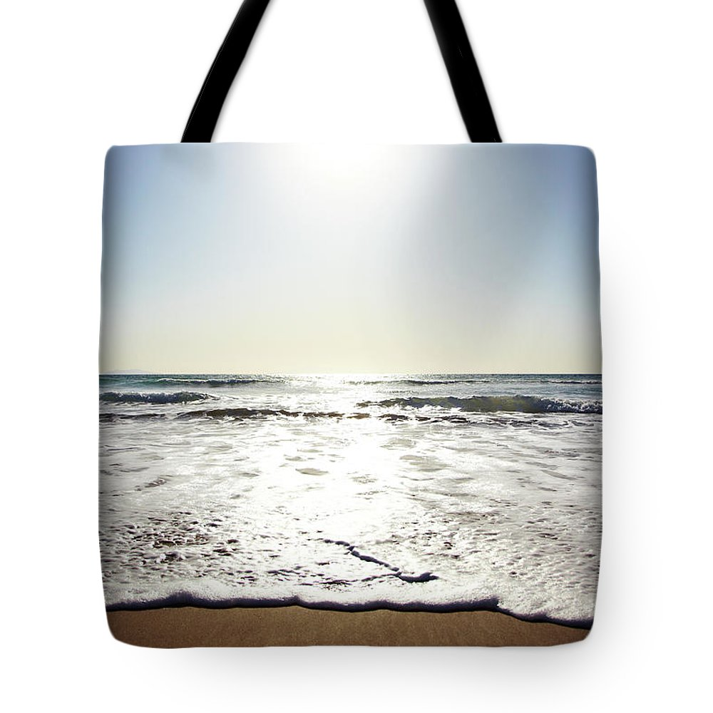 Tranquility Tote Bag featuring the photograph Beach In California On Pacific Ocean by Thomas Northcut