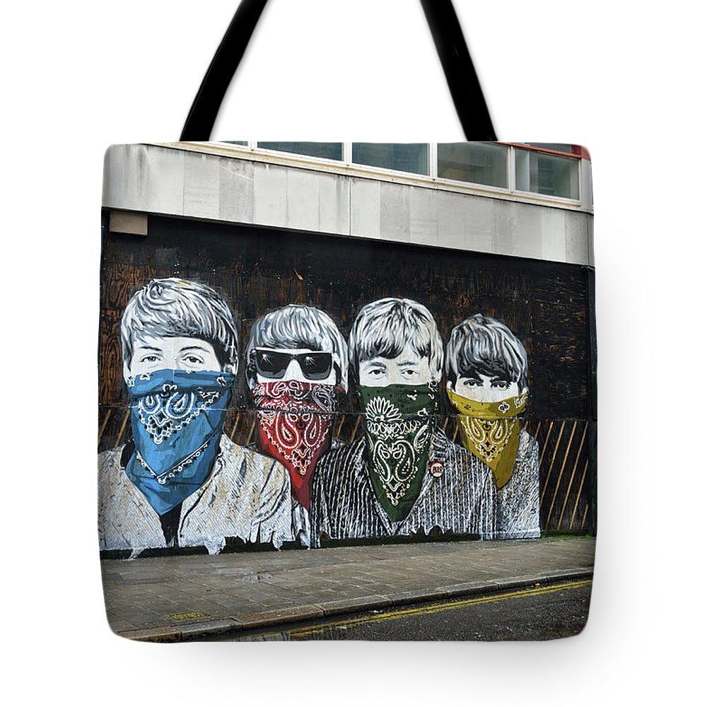 Bansky Tote Bag featuring the photograph Yhe Beatles wearing face masks street mural in London by RicardMN Photography