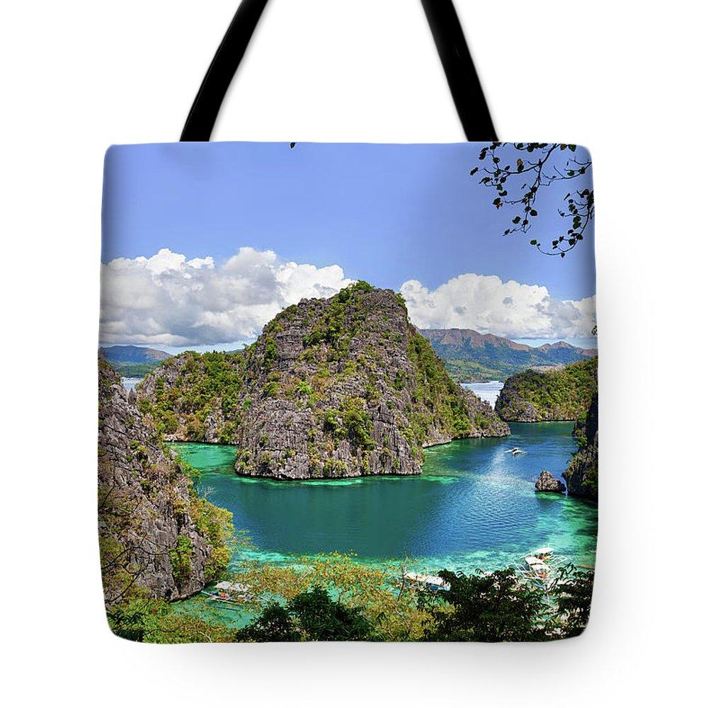 Scenics Tote Bag featuring the photograph Beautiful Blue Lagoon At Kayangan Lake by Fototrav
