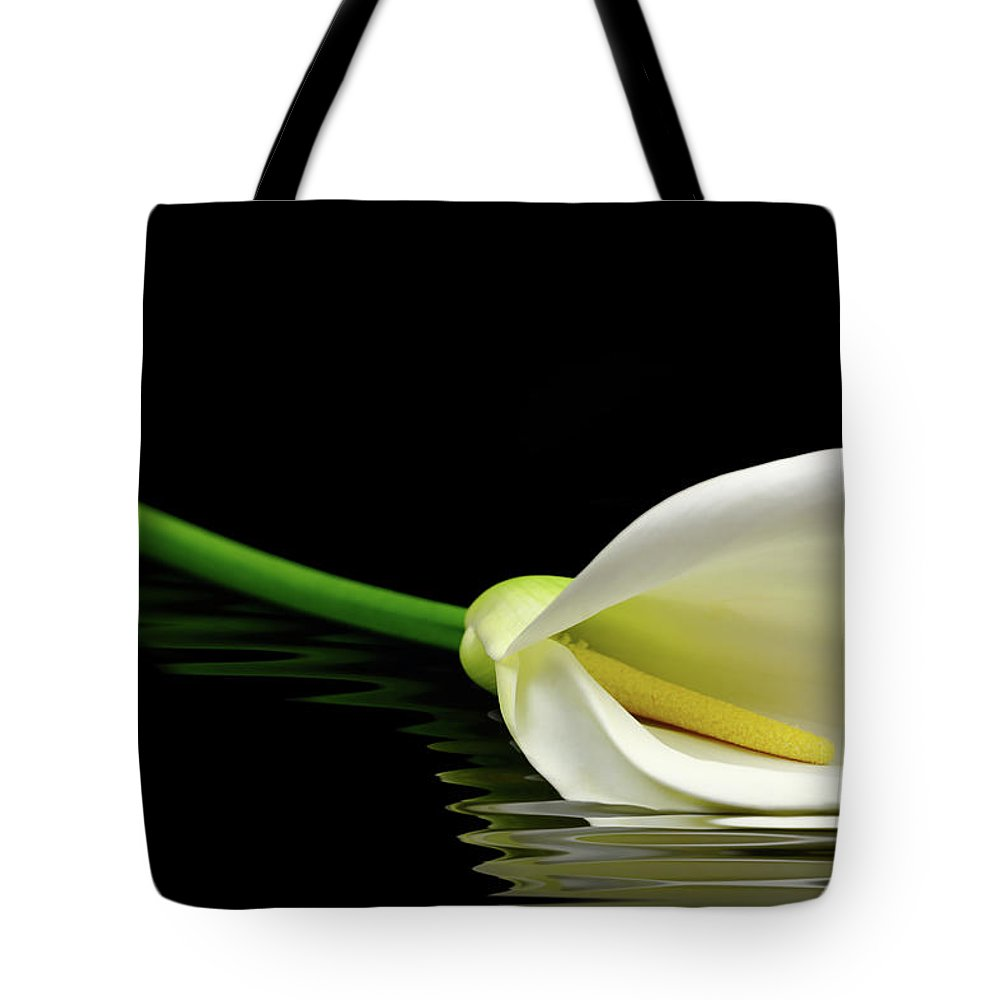 Lilies Tote Bag featuring the photograph Beautiful White Calla Lily Reflected In Water by George Tsartsianidis
