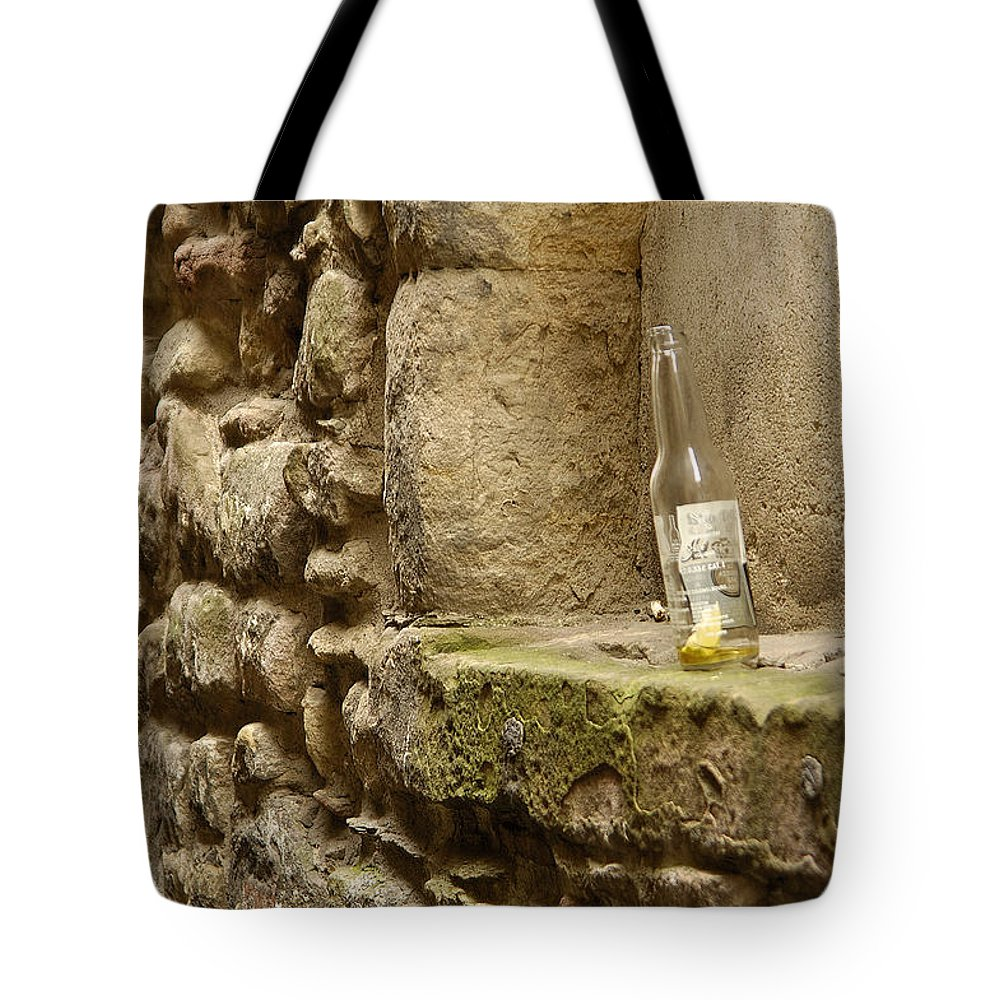 Beer Tote Bag featuring the photograph beer bottle left in old lane in Edinburgh by Victor Lord Denovan