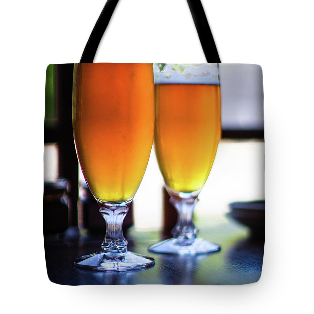 Alcohol Tote Bag featuring the photograph Beer Glass by Sakura chihaya+