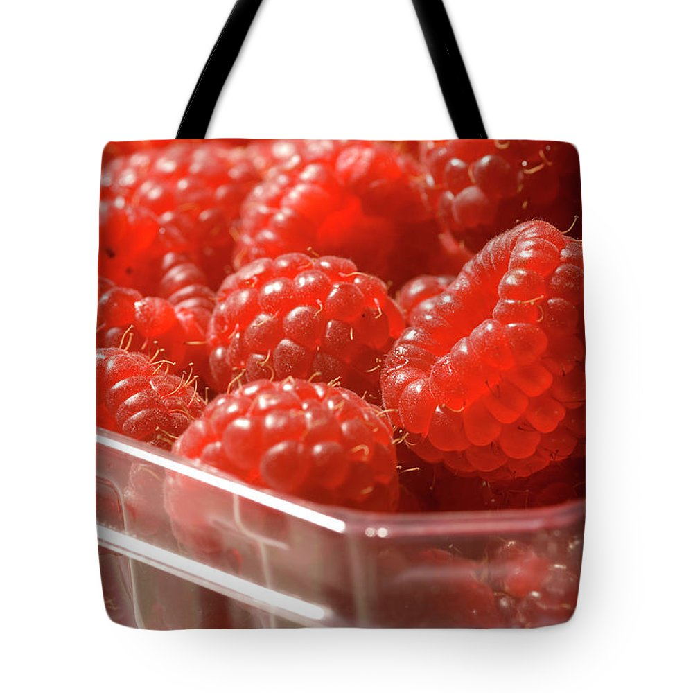 Lifestyles Tote Bag featuring the photograph Berries In Carton by Gwmullis