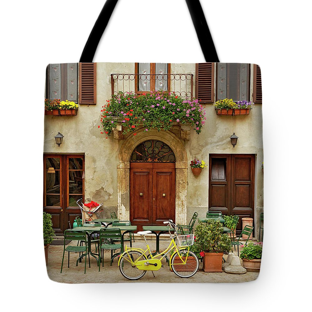 Pienza Tote Bag featuring the photograph Bicycle In Front Of Small Cafe, Tuscany by Adam Jones