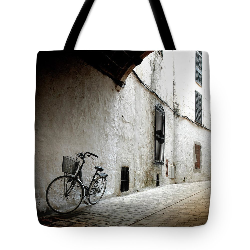 Tranquility Tote Bag featuring the photograph Bicycle Leaning Wall by Antonio R. Ramos