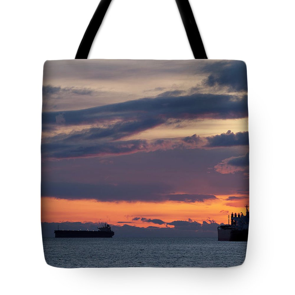 Scenics Tote Bag featuring the photograph Big Boat Silhouettes by Visualcommunications