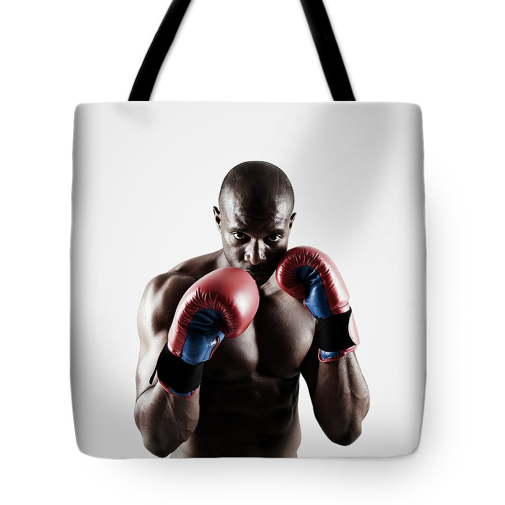 People Tote Bag featuring the photograph Black Male Boxer In Boxing Stance by Mike Harrington