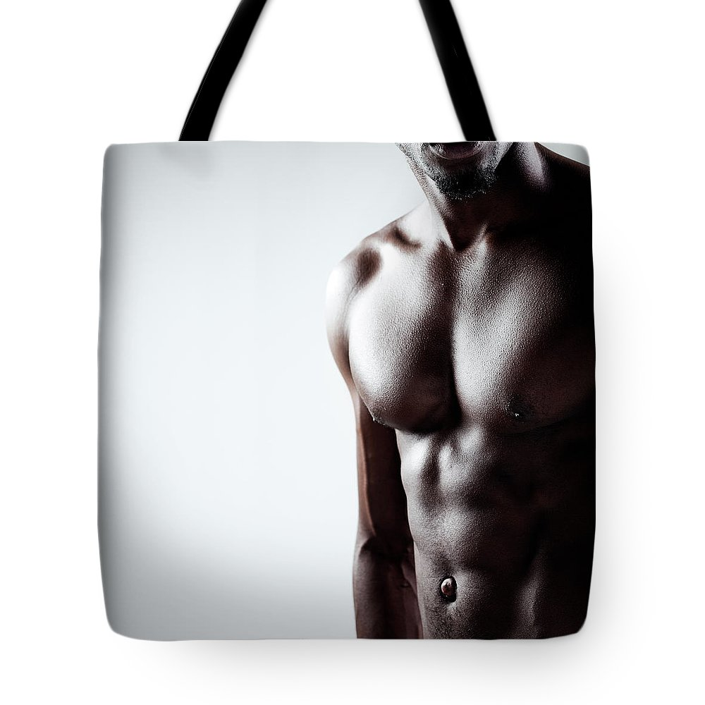 Abdominal Muscle Tote Bag featuring the photograph Black Power by Goldmund