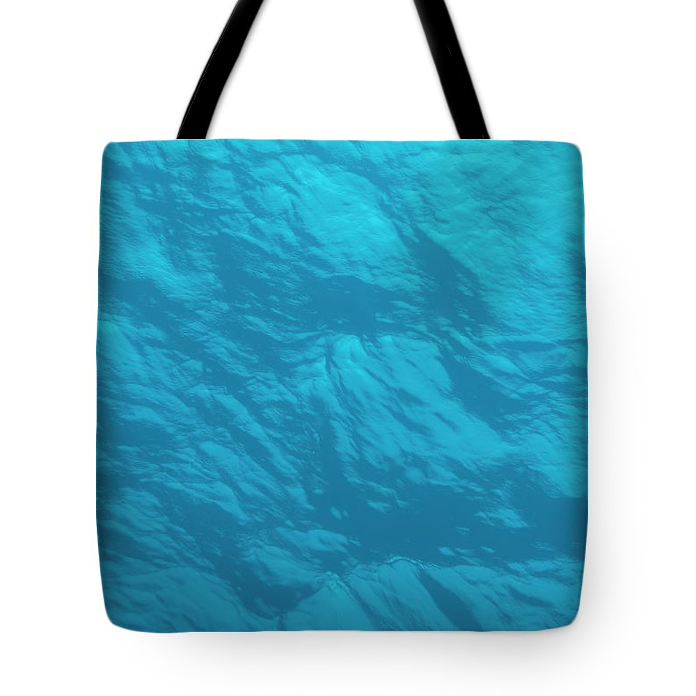 Tranquility Tote Bag featuring the photograph Blue Ocean Water Surface As Seen From by Jeff Hunter