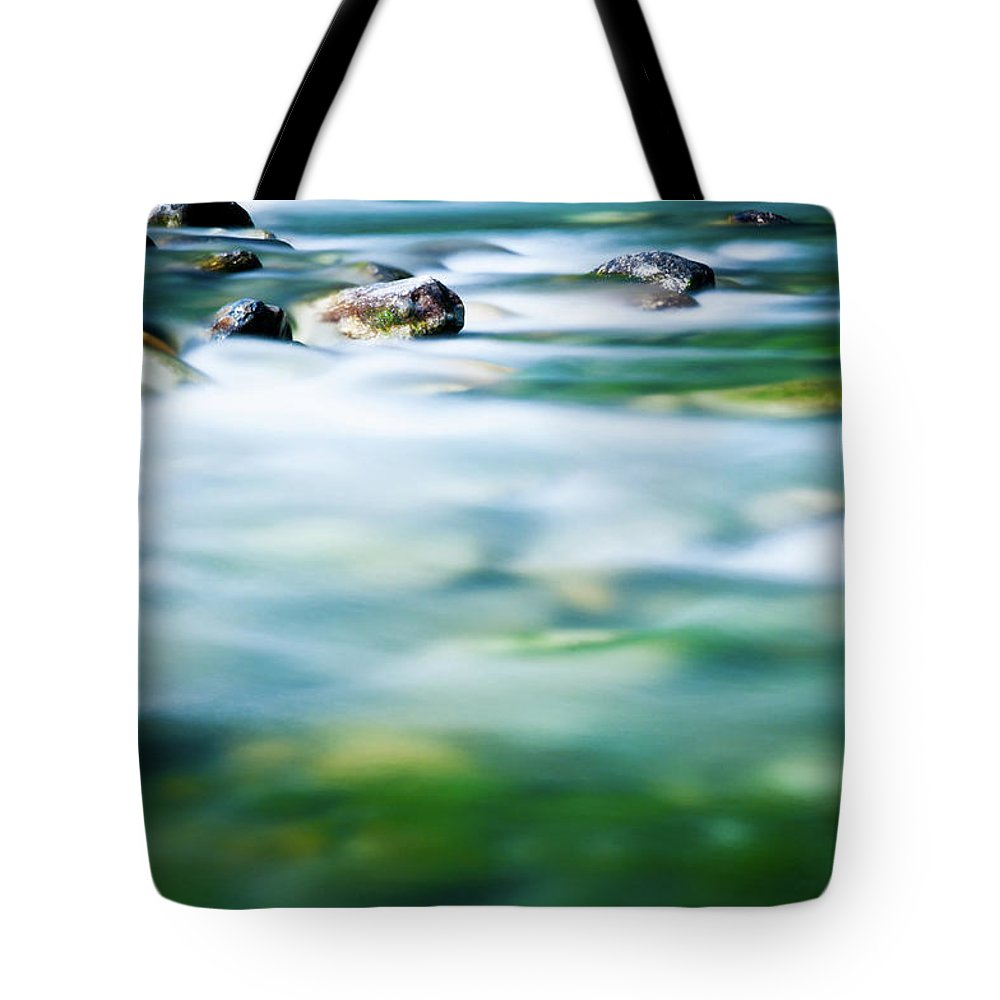 Scenics Tote Bag featuring the photograph Blurred River by Assalve