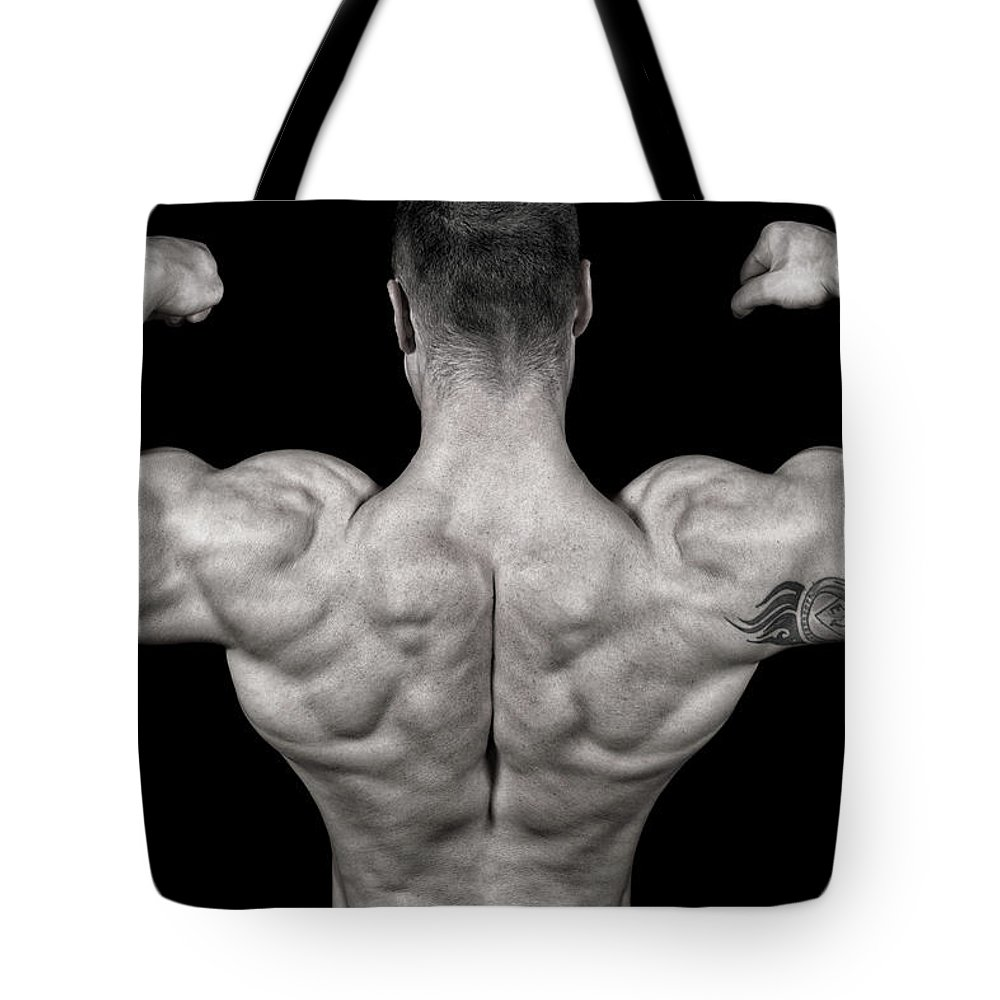 Toughness Tote Bag featuring the photograph Bodybuilder Posing by Vuk8691
