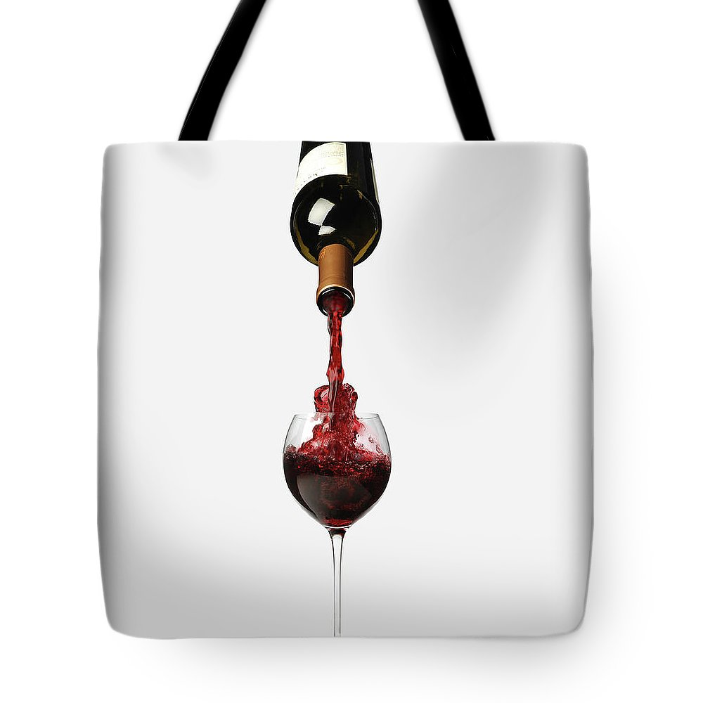 White Background Tote Bag featuring the photograph Bottle Pouring Wine In Wine by Nicholas Eveleigh