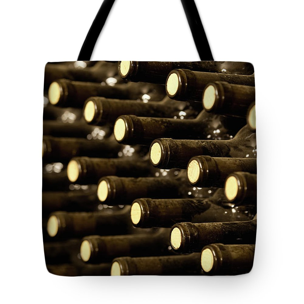 Stellenbosch Tote Bag featuring the photograph Bottled Red Wine Aging In Wine Cellar by Siegfried Layda