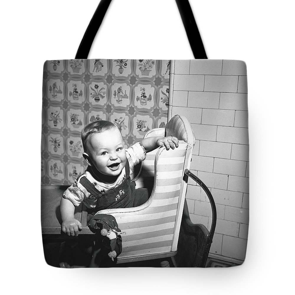 Child Tote Bag featuring the photograph Boy 2-3 Sitting In High Chair, B&w by George Marks