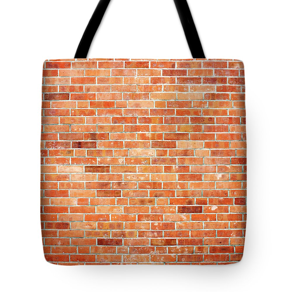 Toughness Tote Bag featuring the photograph Brick Wall by Ballyscanlon
