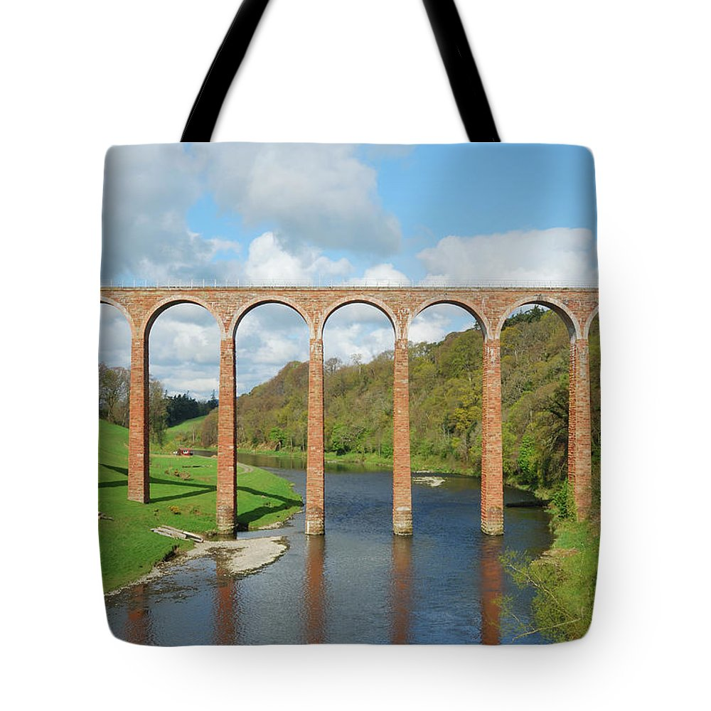 Bridge Tote Bag featuring the photograph bridge over river Tweed near Melrose towards Gattonside by Victor Lord Denovan