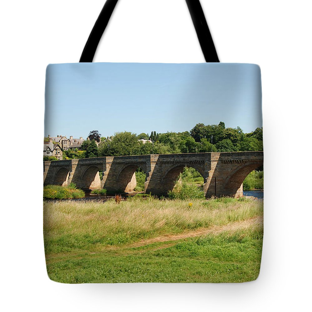 Corbridge Tote Bag featuring the photograph bridge over river Tyne at Corbridge in summer by Victor Lord Denovan