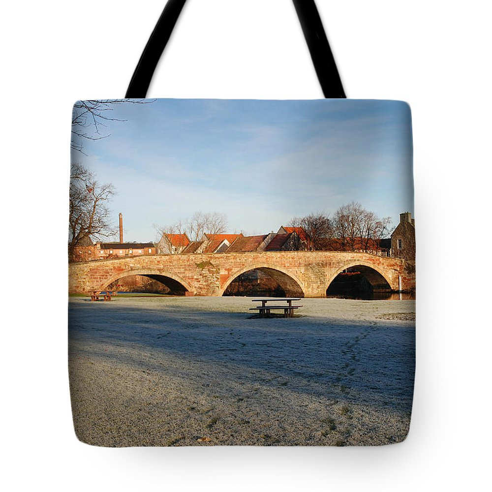 Bridge Tote Bag featuring the photograph bridge over river Tyne in Haddington in winter by Victor Lord Denovan