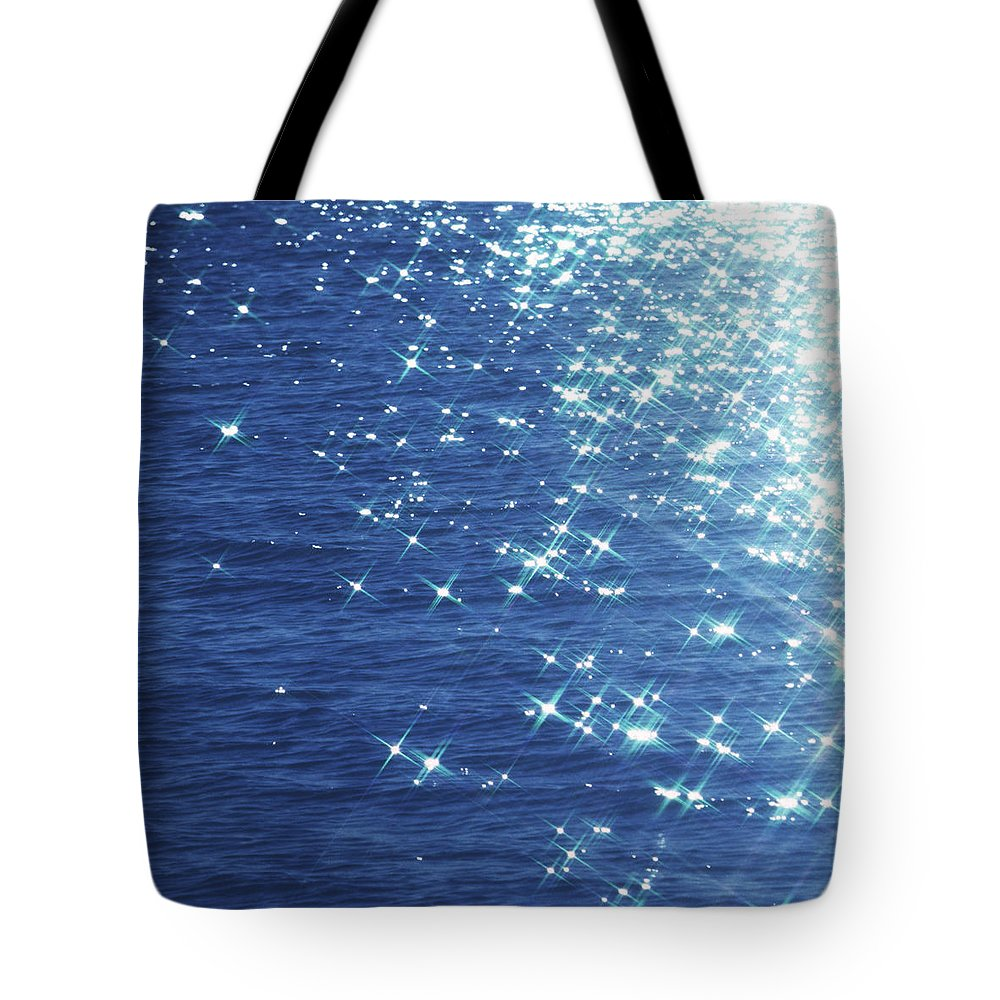 Outdoors Tote Bag featuring the photograph Brightness by Ooyoo