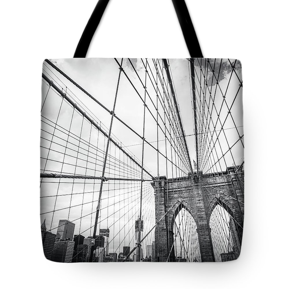 Downtown District Tote Bag featuring the photograph Brooklyn Bridge And New York Skyline by Cirano83