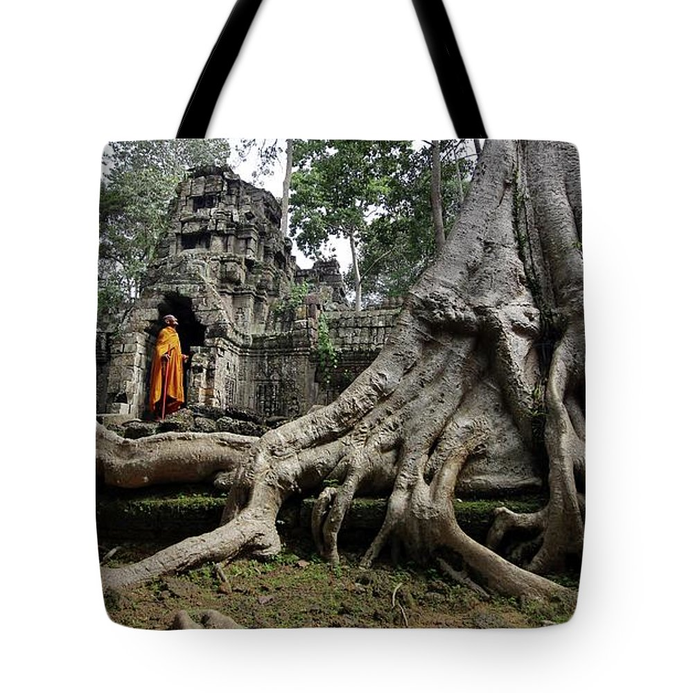 Orange Color Tote Bag featuring the photograph Buddhist Monk At Angkor Wat Temple by Timothy Allen