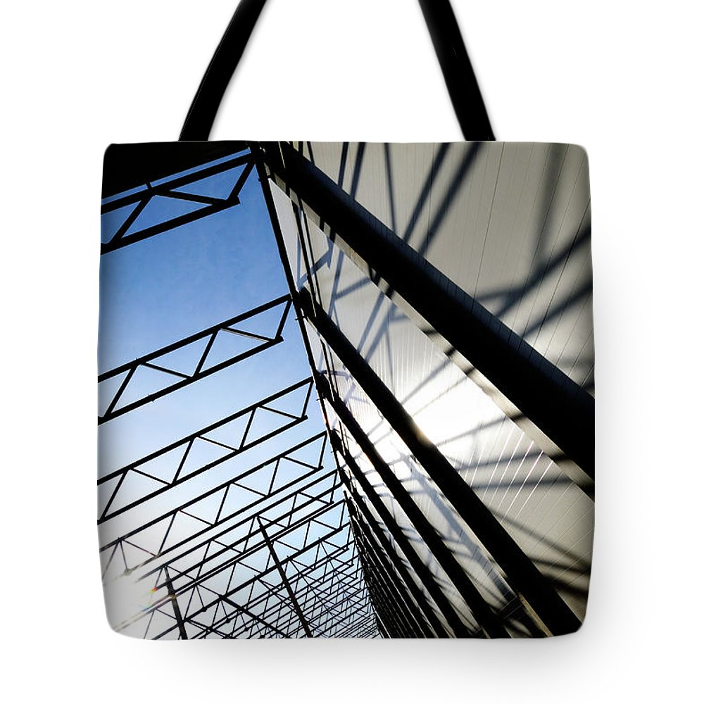 Shadow Tote Bag featuring the photograph Building Abstract by Maximgostev