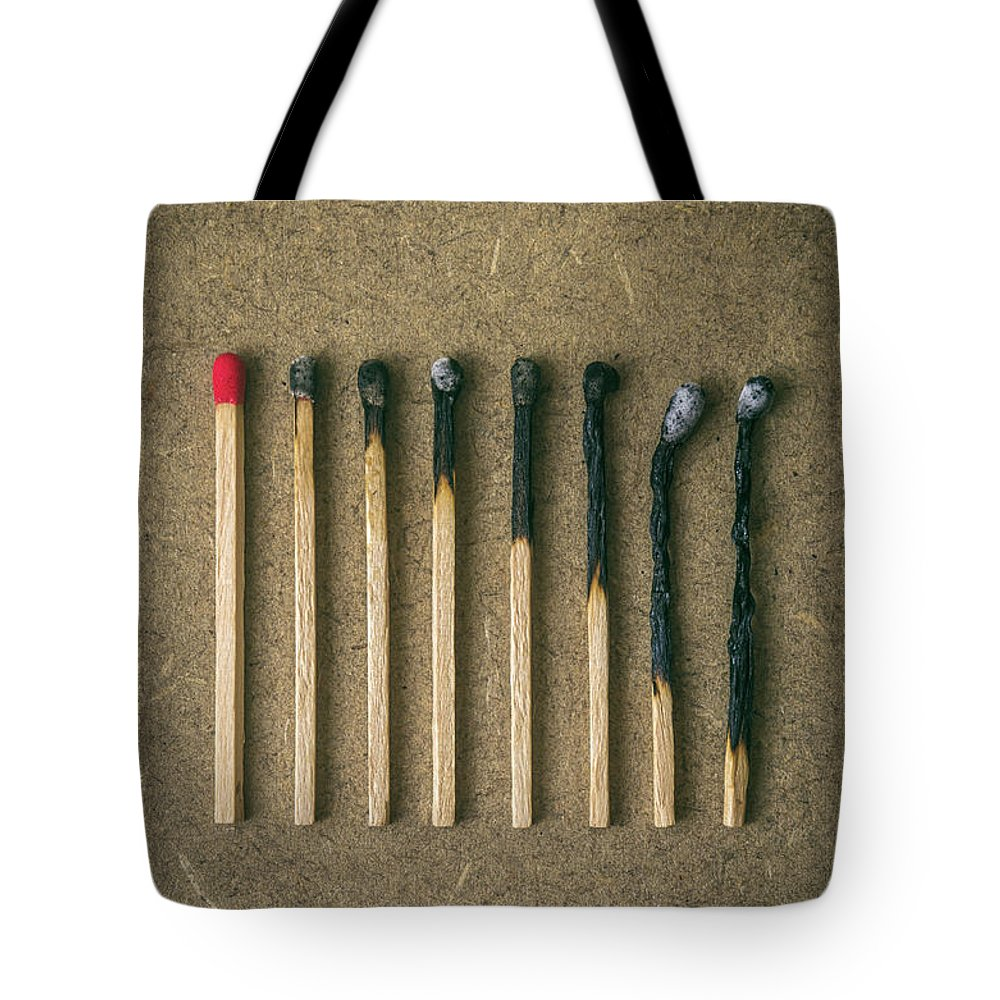 Match Tote Bag featuring the photograph Burnt Matches by Carlos Caetano