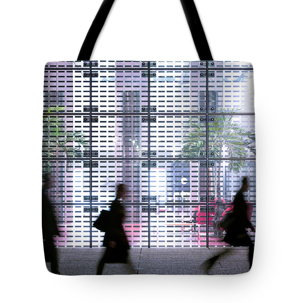 People Tote Bag featuring the photograph Business People Passing Modern Office by Eschcollection