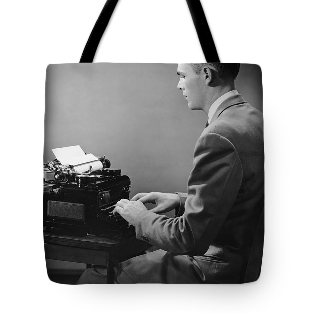 Three Quarter Length Tote Bag featuring the photograph Businessman Inside Office Typing by George Marks